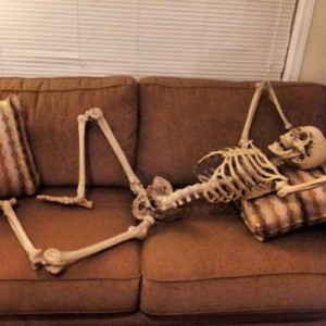 Create meme: The skeleton on the couch