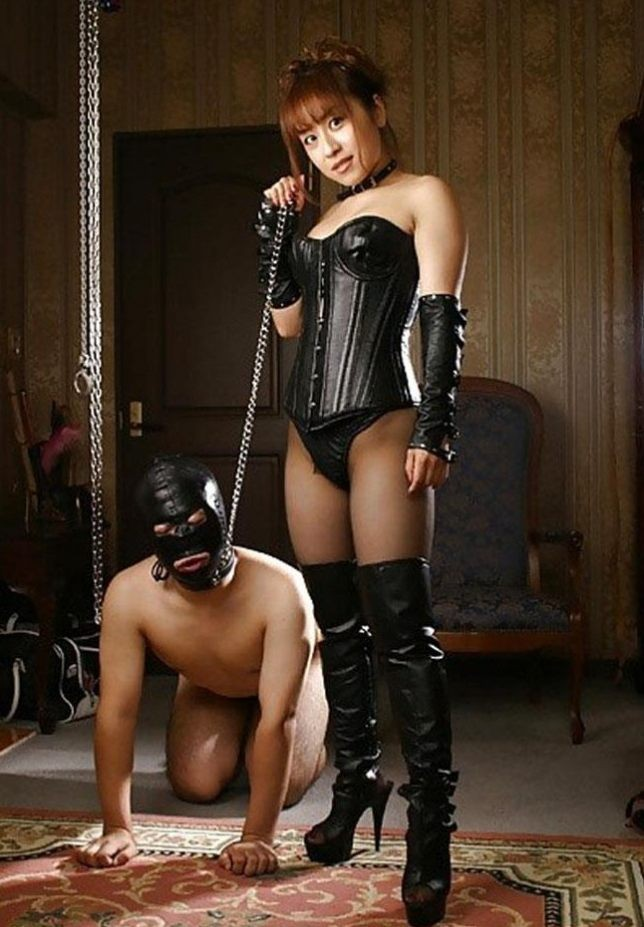 Asian mistress and her male slave doll in bondage