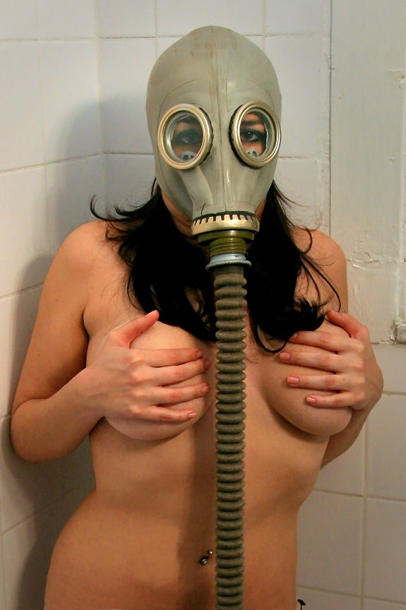 Nude Man With Gas Mask In A Black Background Stock Image